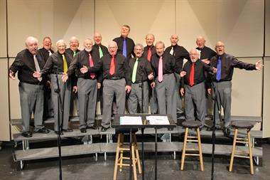 "Space Coast Chorus on stage for the 2016 show ""Unique Holidaze"""
