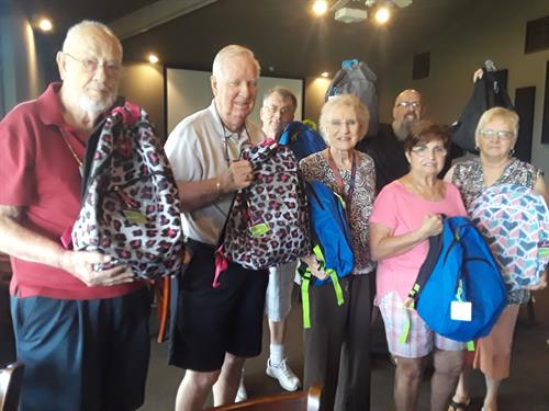 Presenting Grandparents Raising Grandchildren with another load of donated school supplies.