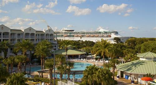 Resort with passing cruise ship