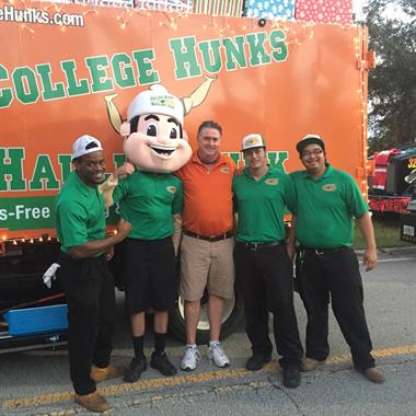 The College Hunks team at the Palm Bay Holiday Lights Parade