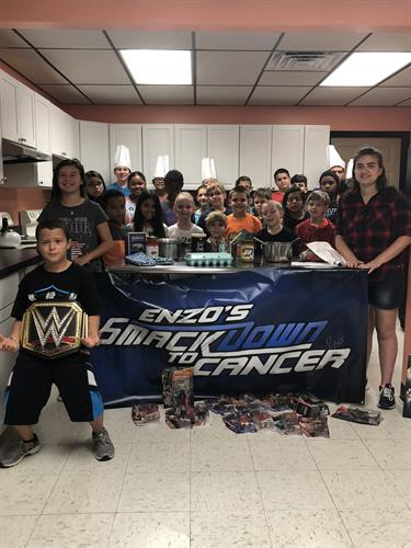 Enzo's Smackdown to cancer invitation for The Rock to cook with the students.