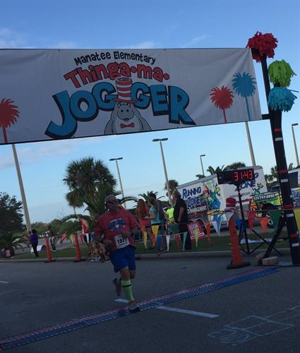 Steve finishing a 5K race at Manatee Elementary in Viera
