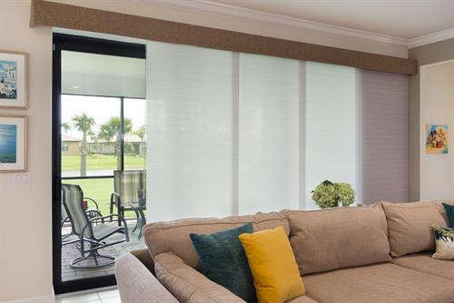 This Signature sliding solar shade panel track is the perfect way to get some privacy despite your revealing sliding glass doors. Their unique design also provides a point of conversation when entertaining guests.