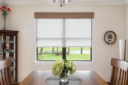 These Springs roller shades combined with a Horizons Flat Flap valance make the perfect pair in this kitchen dining space. They will allow just the right amount of natural light through while you dine with family or friends.