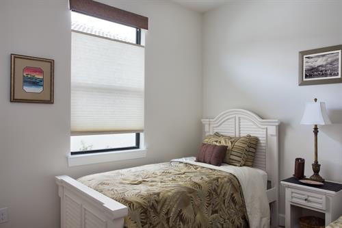 Top down bottom up shades are a great window covering that can adapt to any time of day. Here, these Norman SmartFit shades can be left open on the top to provide some light, but almost shut on the bottom for privacy.