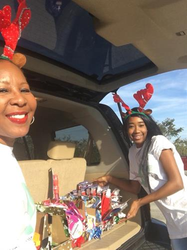 CEO Annette Watson-Johnson and VP Octavia Cosby happy to volunteer at toy giveaway