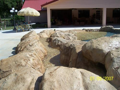 Artificial rock - lazy river into pool