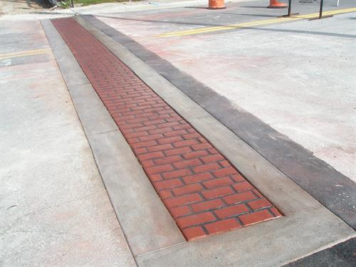 (AFTER)... Completed stamped concrete (Brick) pattern Municipal city walk-way