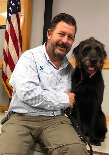 Co-founder with service dog Old Glory