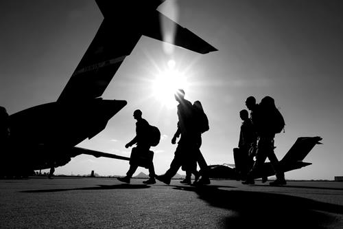 Members of the 306th Rescue Squadron walk on the flight line towards a C-17 Globemaster III at Davis-Monthan Air Force Base, Ariz., June 1, 2019. The 306th Rescue Squadron's mission is to rescue isolated personnel or equipment...anytime, anywhere. (U.S. Air Force photo by Andre Trinidad.)