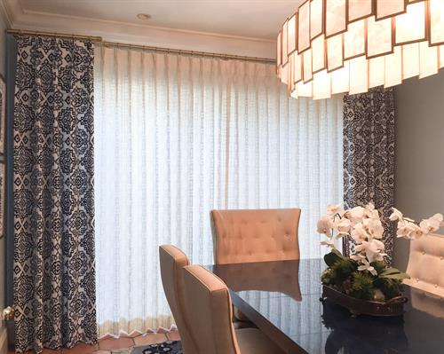 Custom draperies in a dining room on Lansing Island - we fabricate all draperies in our workroom.