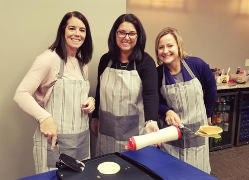 Partners, Michelle Hanson, Annette Benson and Jennifer Lownsbury serving United Way breakfast