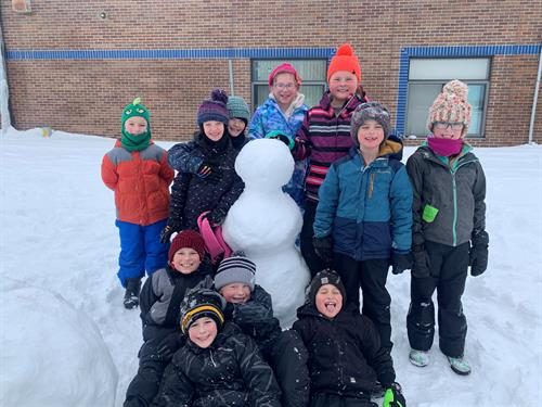 Playing in the snow during recess.