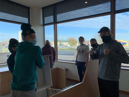 Moving Day! Willmar WarHawk Hockey players help this hockey mom move heavy office furniture as the clinic takes shape.