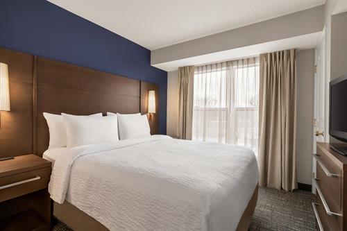 One Bedroom Queen Suite - Bedroom Area