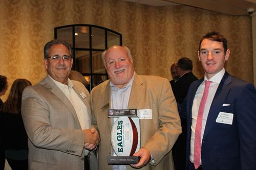 Ed won a signed Eagles football!