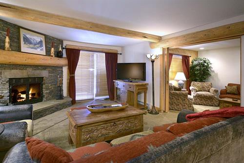 Living rooms feature beautiful stone fireplaces to keep warm.