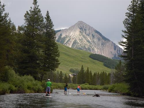 Crested Butte mountain provides a senic backdrop for Upper Slate River SUP floats