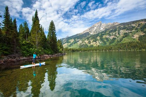 Placid alpine lake SUP