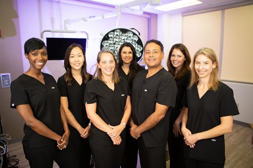Modern Ob/Gyn offers minimally invasive surgery options in-office at our Johns Creek location. Here are our skilled surgeons, from left to right, Dr. Natu Mmbaga, Dr. Annie Kim, Dr. Ingrid Reyes, Dr. Stacey Pereira, Dr. John Reyes and Dr. Christy Kenkel joined by Certified Nurse Midwife, Nuria Nelkin.