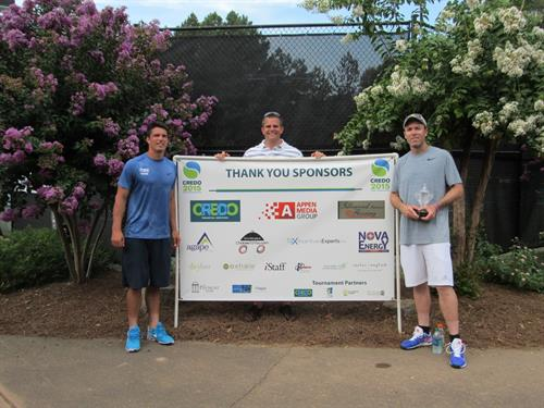 Gallery Image Dan_with_runners_up_in_front_of_sponsor_sign.jpg