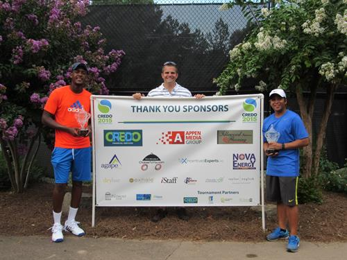 Gallery Image Dan_with_winners_in_front_of_Sponsor_sign.jpg