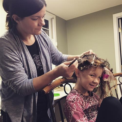 My niece receiving a lice treatment