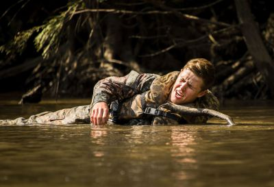 A U.S. Army Soldier attending Ranger School simulates being wounded and yells for help while lying in the river during a mass casualty exercise at Eglin Air Force Base, Fla, Sept. 28, 2016. Three groups of Soldiers in small boats encountered a simulated civilian and Army boat crash. The Soldiers acted as first responders to triage the victims, coordinate to receive help and get the wounded to local emergency technicians. U.S. Air Force photo by Samuel King Jr.