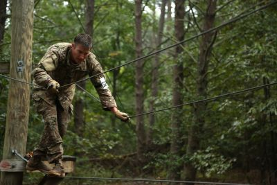 A U.S. Army Special Operations Command Soldier walks across a rope bridge during the 2016 Best Warrior Competition at Fort A.P. Hill, Va., Sept 27, 2016. U.S. Army photo by Pfc. Jada Owens