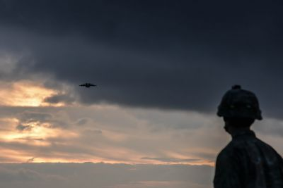 A 173rd Airborne Brigade Soldier watches a U.S. Airforce C17 Globemaster III conducting a heavy equipment drop at Bunker Drop Zone, Grafenwoehr, Germany, Oct. 18, 2016, part of Peacemaster Unity training. Peacemaster Unity is a joint multinational readiness exercise that unifies seven nations, by conducting missions across three countries, and delivering more than 2,000 troops and 20 heavy drops. U.S. Army Photo by Spc. Sara Stalvey