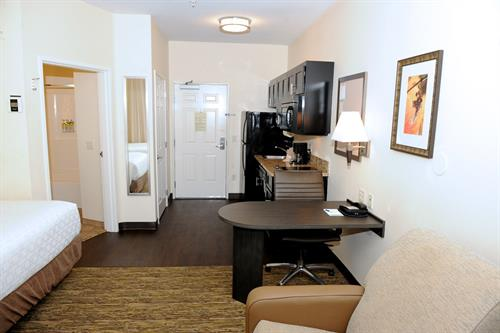 Every suite offers a full kitchen including stove top, refrigerator, microwave and coffee-tea maker
