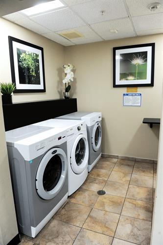 Guest laundry room offering free washer & dryers