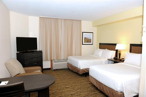 Suites offering a work desk, free high speed Internet and a flat screen TV with free movie channels