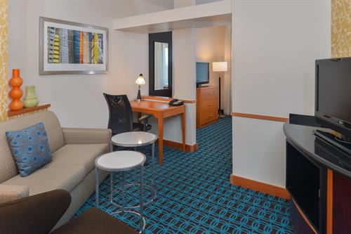 Suites feature separate living & sleeping areas