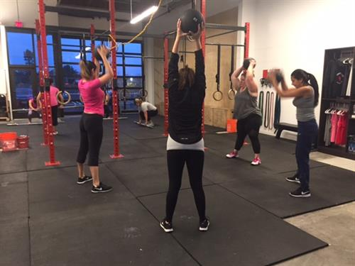 Boot Camp ladies working with 10 lb ball slams