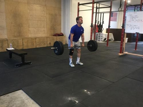 60+ year old member Don working on deadlifts.