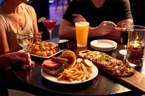 In-house bar and grill with nightly entertainment, sixteen screens, local drafts, farm fresh menu, billiards, and dartboards.