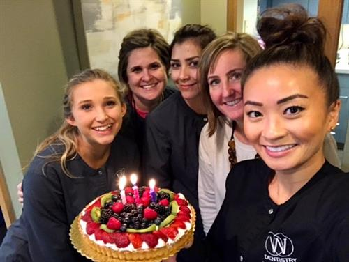 Dr. Woo and team celebrating a birthday.