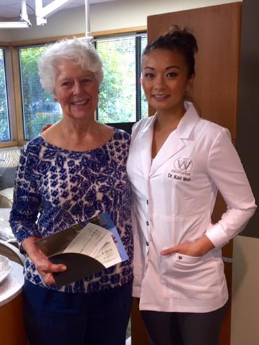 Dr. Woo with one of our patient contest winners.