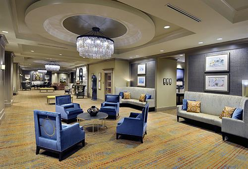Our Grand Foyer offers comfortable seating areas and stunning decor