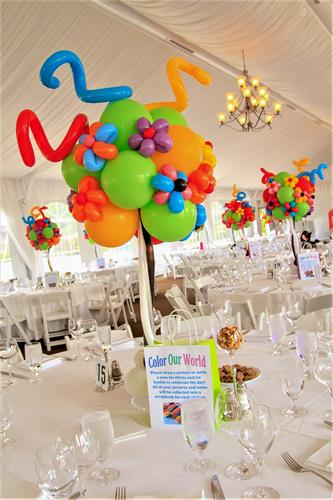 Colorful custom topiary-style table toppers to match the invitations.