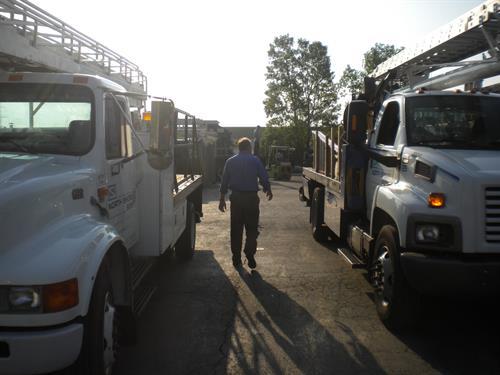Company President Duane Laska w/ Trucks