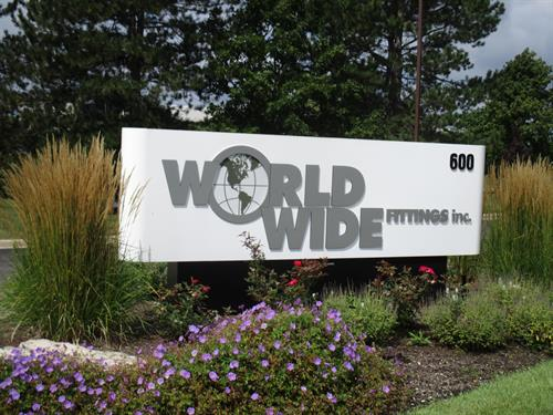 World Wide Fittings Inc. Freestanding Sign