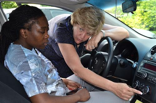 Jeanne Silver going over the vehicle with Caresse.