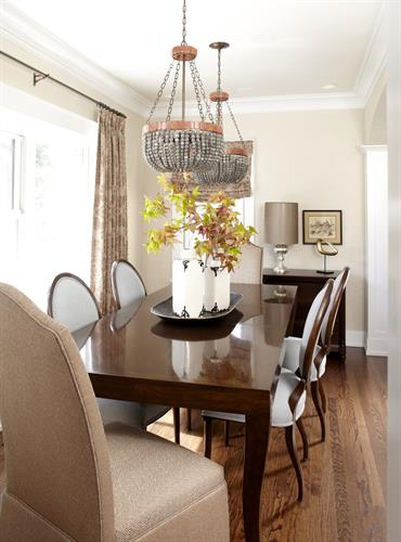 Twin chandeliers are just one of the designer touches in this charming dining room.
