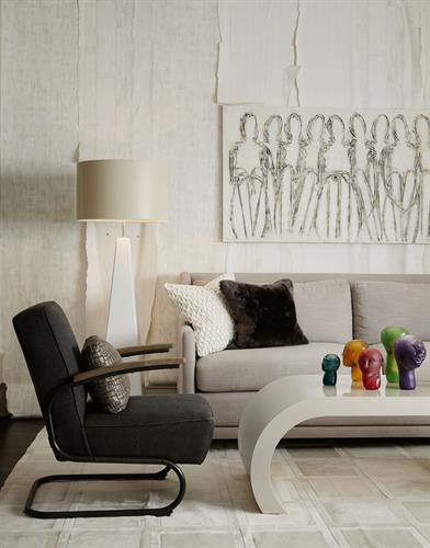 Curves plus angles equal geometric excitement in a cozy-hip family room.