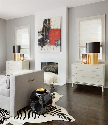 A pair of chunky gold lamps add sparkle to this urban-chic family room.