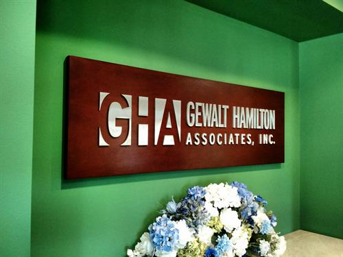 Aluminum Dimensional Lettering on Cherry Wood Background