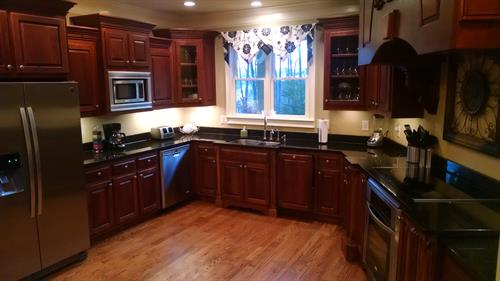 Oversized kitchen with granite countertops, stainless steel appliances & wine cooler