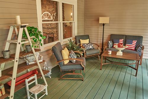 Porch with seating area. One of 3 porches.